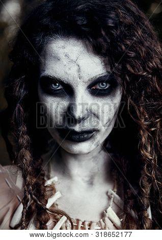 Halloween Theme: Creepy Grim Voodoo Witch. Close-up Portrait Of The Evil Sorceress. Zombie Woman (un