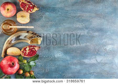 Rosh Hashanah - Jewish New Year Holiday Concept. Traditional Symbols: Honey Jar And Fresh Apples Wit
