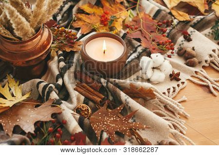 Candle With Berries, Fall Leaves, Anise,herbs, Acorns, Nuts, Cinnamon, Cotton On Brown Blanket. Hygg
