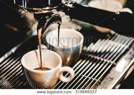 Espresso Machine Brewing A Coffee. Coffee Pouring Into Glasses In Coffee Shop, Espresso Pouring From