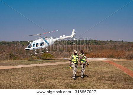 Victoria Falls, Zimbabwe - August 2 2019: Zambezi Helicopters Aircraft Starting For Victoria Falls S