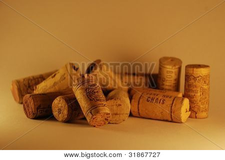 wine corks randomly laying on the surface poster