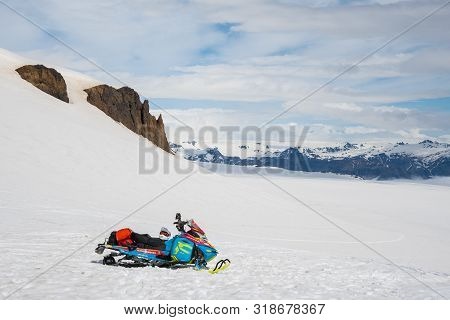 Vatnajokull Iceland - June 17. 2019: Blue Snowmobile On Skalafellsjokull Glacier A Part Of Vatnajoku