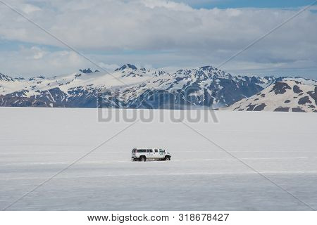 Vatnajokull Iceland - June 17. 2019: Modified 4x4 Minibus Driving With Tourists On Skalafellsjokull