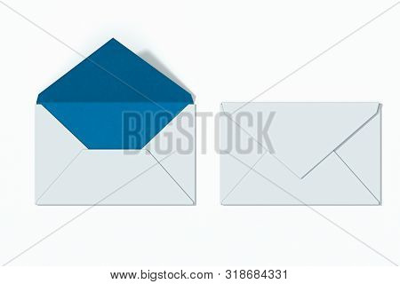 White Opened Envelope Light Blue Inside Near Closed Blank Envelope Isolated On White Background.