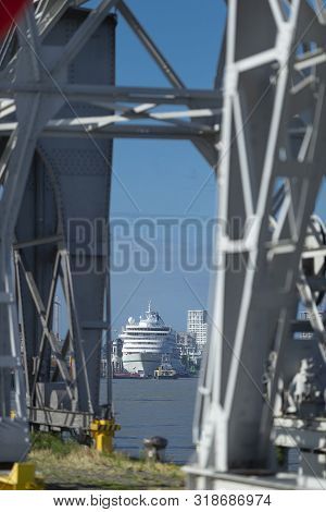 A cruise ship has just arrived in the harbour of Antwerp