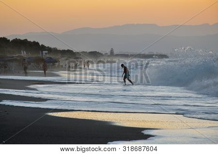 Platanias, Crete - August 24: Wave Breaks During The Storm At Sunset In Platanias, Crete On August 2