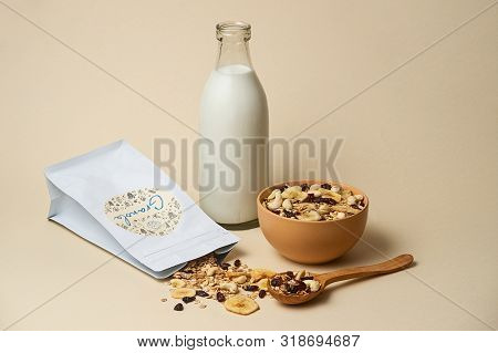 06.19.2019 Kyiv, Ukraine.nutrition Concept. The Bowl Of Granola With  Milk Bottle, Wooden Spoon And
