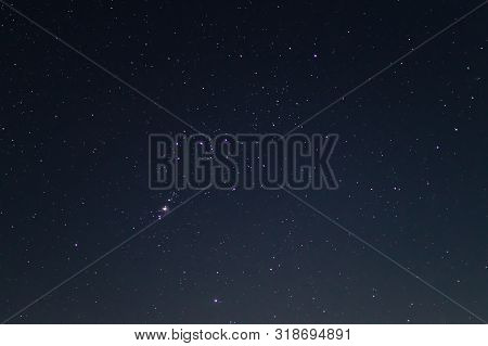 Night Sky Low Light Photo. A Lot Of Stars And Constellations On Dark Sky. Stock Photo Of Deep Sky. F