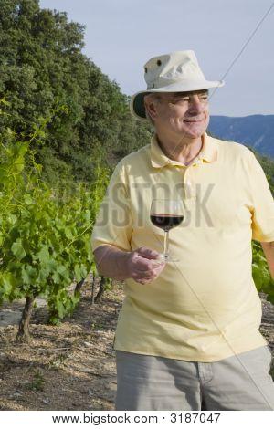 Mature Man With Wine