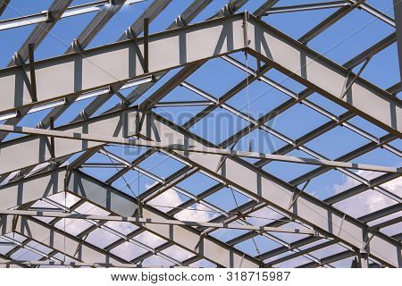 Steel Structure Of Building Construction On Sky Background