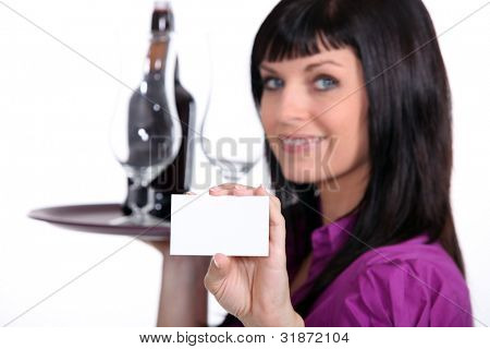 Sommelier holding up her business card