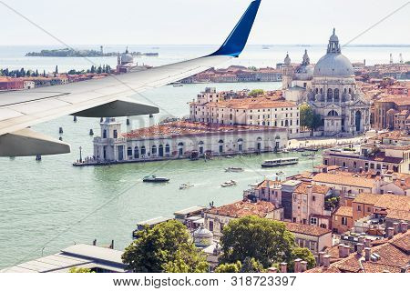 Plane Flies Above Venice, Italy