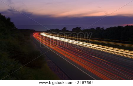 An image of traffic on the m6 in england with motion blur. poster