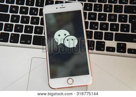 Palo Alto / Usa - August 08 2019: White Iphone With Logo Of Social Media Wechat On The Screen. Socia