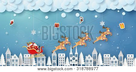 Origami Paper Art Of Santa Claus And Reindeer Flying On The Sky With Hanging Gifts, Merry Christmas