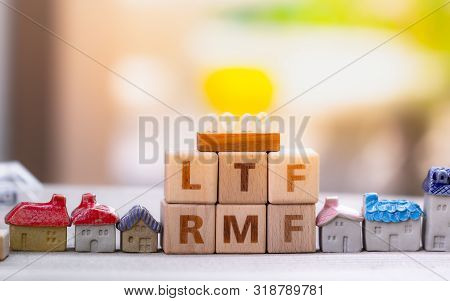 Wood Block Word Ltf And Rmf With Copy Space Using As Background Business Financial, Saving Money, Re