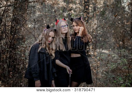 Halloween Daemon, Maniac And Witch In The Woods