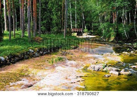 Finland, Kotka: Langinkoski Rapid On The Kumi River, Forest Stream With A Bridge.