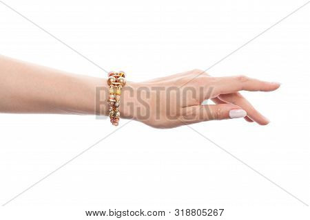 Hand In Jewelry Bracelet With Opal, Amber, Jasper, Pearls And Gold Beads Isolated On White Backgroun