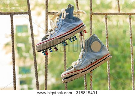Old Worn-out And Leaky Football Shoes With Homemade Spikes From Roofing Screws Were Washed And Dried