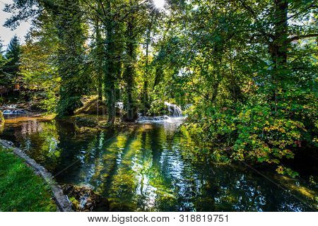 Calm flow of the forest river after a waterfall. Travel to Croatia. The Croatian town of Slunj. Cascade of waterfalls on the Sluncica River. The concept of ecological, active and photo tourism