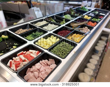 Fresh Salad Bar With Various Fresh Assortment Of Ingredients, Fruits And Proteins  Variety Of Vegeta
