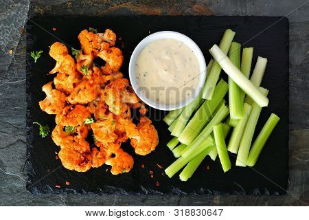 Cauliflower Buffalo Wings With Celery And Ranch Dip. Top View On A Slate Serving Platter. Healthy Ea