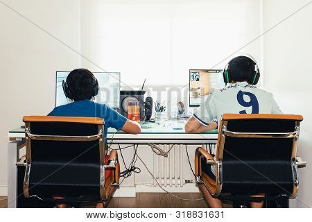 Madrid, Spain - August 23, 2019: Teenagers Playing Fortnite Video Game And Csgo Counter Strike On Pc