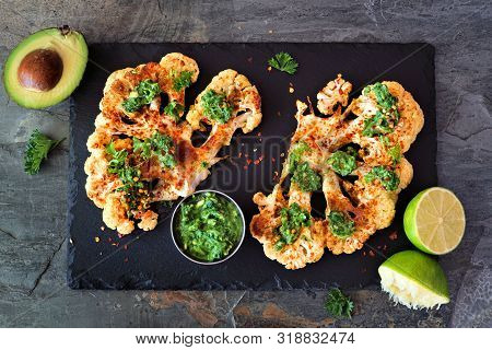 Cauliflower Steaks With A Cilantro Lime Sauce. Above View On A Slate Platter. Healthy Eating, Plant