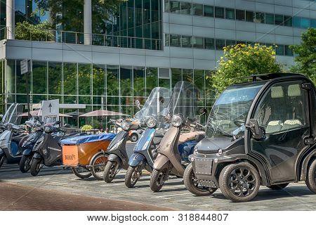 Amsterdam, Gustav Mahlerlaan, The Netherlands, 05/29/2019,  Scooters Parked At The Sidewalk, Modern