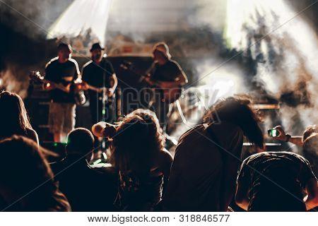 Group Of Happy People Enjoying Rock Concert