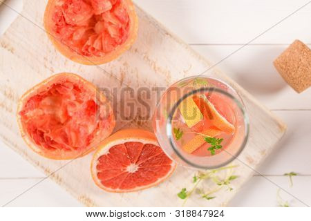 Healthy Summer Drink Grapefruit Lemonade With Thyme In Glasses With Ice On A Wooden Surface.