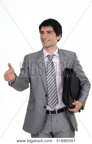 Businessman offering his hand
