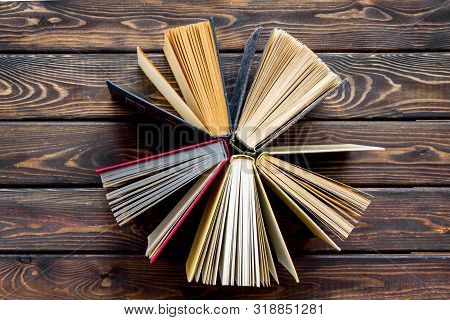 Books On Library Desk For Reading And Education On Wooden Background Top View