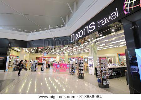 London England - June 6, 2019: Unidentified People Visit Dixons Travel Shop Heathrow Airport London