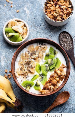 Breakfast Yogurt Bowl With Fruits, Granola, Chia Seeds. Table Top View. Greek Yogurt With Kiwi, Bana