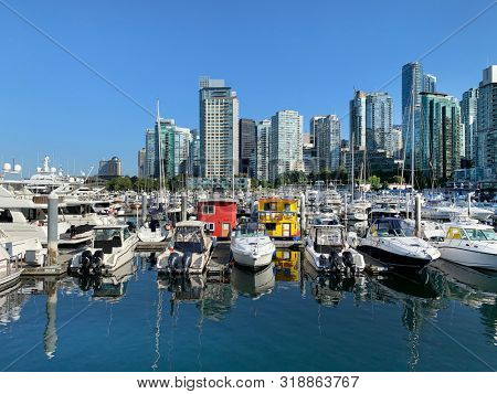Luxury yachts, boats and condominiums in Vancouver's Coal Harbour. British Columbia Canada