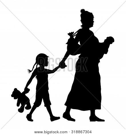 Refugee Woman With Her Baby And Little Daughter Silhouette. The Silhouette Objects And Background Ar