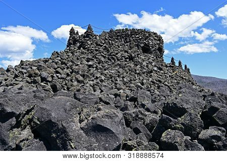 Dee Wright Observatory At Summit Of Mckenzie Pass Overlooking Lava Fields In Willamette National For