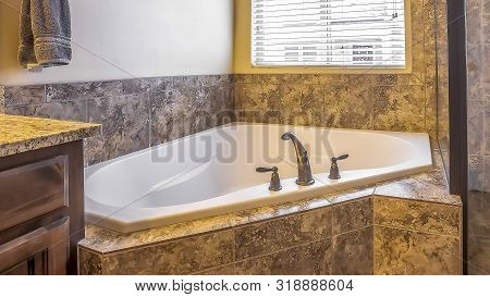 Panorama Bathroom Interior With Built In Bathtub Shower Stall And Marble Tile Wall