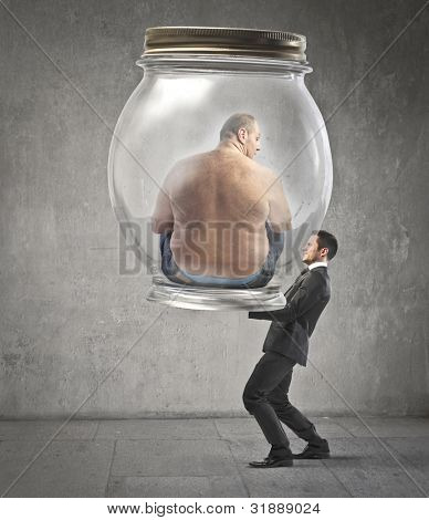 Businessman carrying a jar with an obese man in it poster