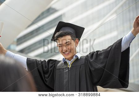 Graduate Student And Success Education In University Concept. Happy Asian Student Man Graduate Diplo