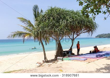 Phuket, Thailand - October 16th 2014: Massage Girls Sat Under A Tree Waiting For Business, Surin Bea