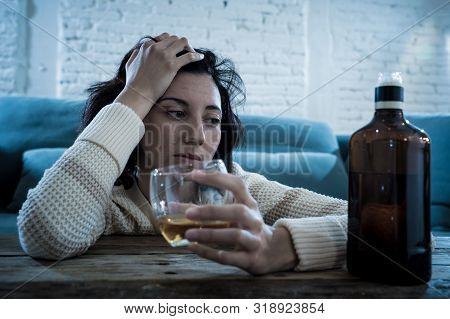 Young, Sad, Unhappy, Helpless Woman Drinking Alcohol. Human Emotions, Alcoholism And Addictions