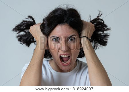 Close Up Of Young Frustrated Caucasian Woman With Angry And Stressed Face. Looking Mad And Crazy Sho