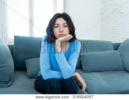 Bored Woman Changing Tv Channels With Remote Control