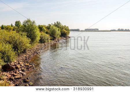 Stones On The Waterfront Of The Dutch River Waal Near The Village Of Vuren, Gelderland. Many Stones