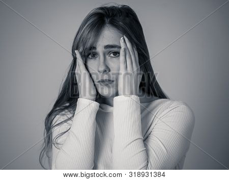 Portrait Of Sad And Intimidated Woman. Isolated In White Background. Human Expressions And Emotions