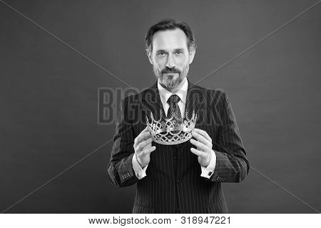 It Is His Proud Boast. Source Of Pride. Proud Businessman Holding Crown Jewel With Pride On Red Back